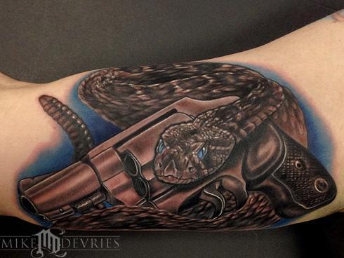 mike devries tattoos realistic snake and gun tattoo